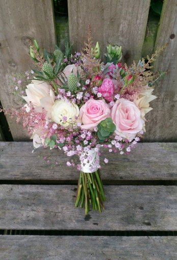 Pretty in #pink bride's bouquet with #thistle texture