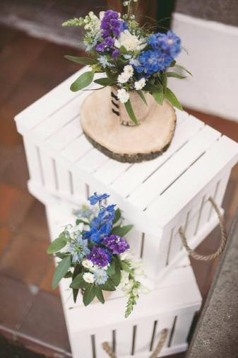 Rustic crates with jam jar posies.
