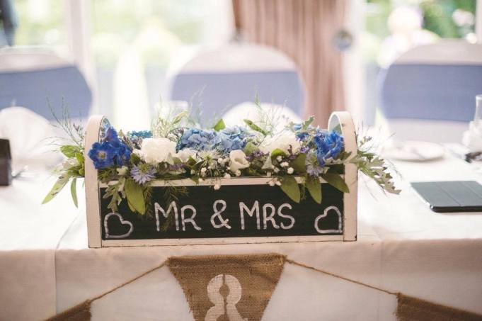 'Mr & Mrs' chalkboard top table arrangement.
