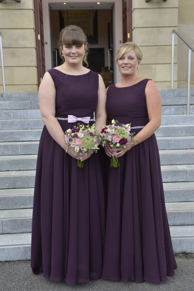 Bridesmaids in a rich aubergine with lilac belt detail